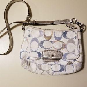 Silver and blue Coach purse